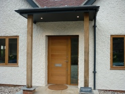 Handmade oak timber front door and gate 1