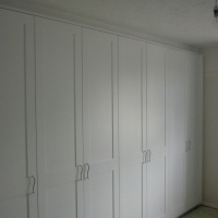 Bespoke built in Bedroom furniture covering existing chimney breast